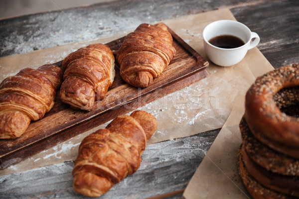 Cropped image of a lot of pastries croissants on table Stock photo © deandrobot
