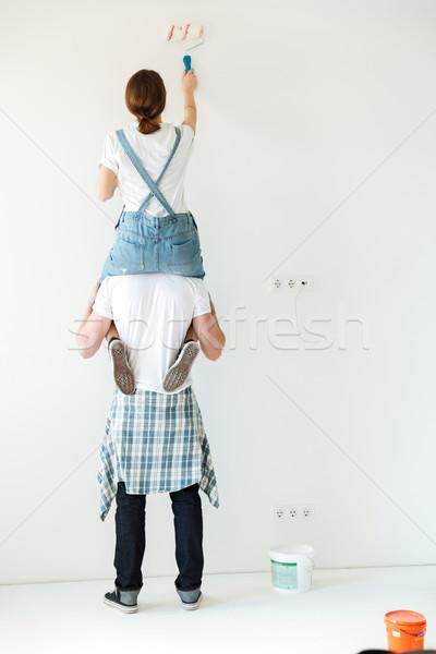 若い女の子 座って 壁 背面図 彼氏 肩 ストックフォト © deandrobot