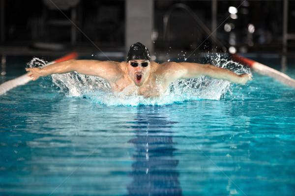 молодые мужчины пловец плаванию бабочка спорт Сток-фото © deandrobot