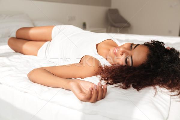 Giovani african donna godere sole letto Foto d'archivio © deandrobot