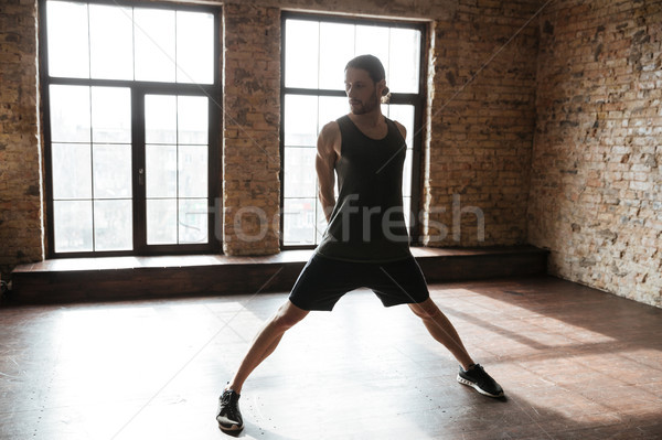 Portrait of a young sportsman working out at the gym Stock photo © deandrobot