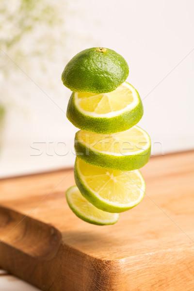 Közelkép szeletel egész citrus repülés fölött Stock fotó © deandrobot