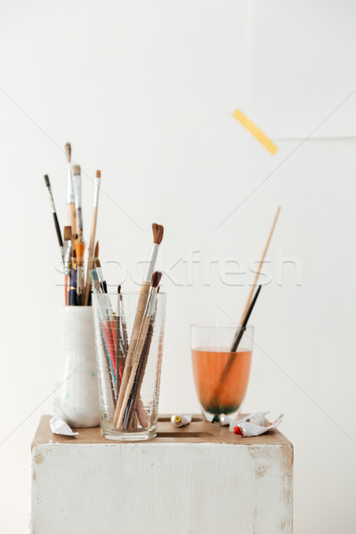 Painting brushes over white wall. Stock photo © deandrobot
