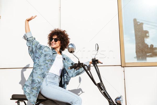 улыбающаяся женщина сидят современных мотоцикле Сток-фото © deandrobot