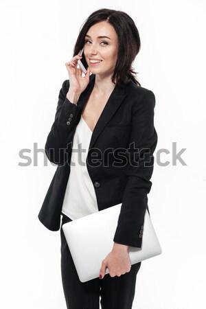 Portrait of a happy attractive businesswoman Stock photo © deandrobot
