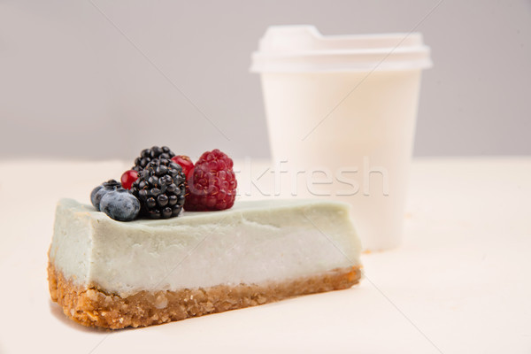 Blue cheesecake near paper cup isolated Stock photo © deandrobot