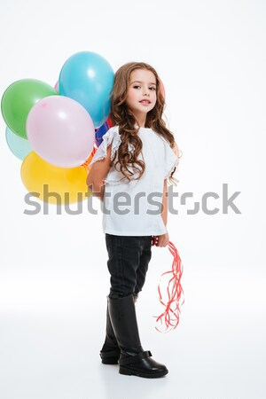 Happy woman with air balloons looking camera snd smiling Stock photo © deandrobot