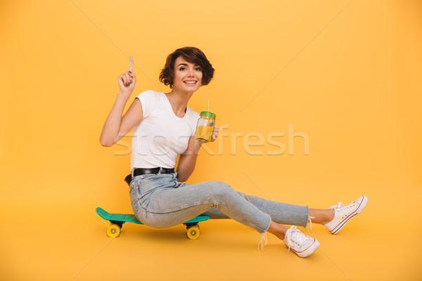 портрет улыбаясь привлекательная девушка сидят скейтборде стекла Сток-фото © deandrobot