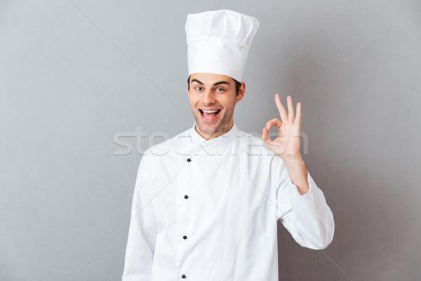 Alegre jóvenes cocinar uniforme bueno Foto stock © deandrobot