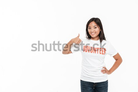 Cheerful young woman with okay gesture winking. Stock photo © deandrobot