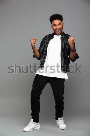 Teljes alakos fotó fiatal afro amerikai szerencsés Stock fotó © deandrobot