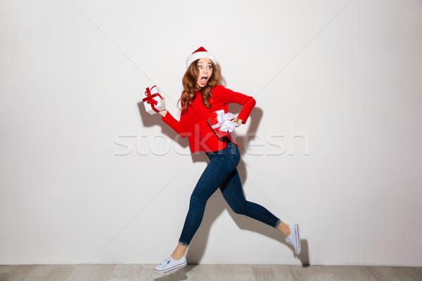 Full length portrait of girl dressed in red sweater Stock photo © deandrobot