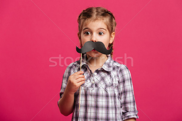 Petite fille enfant faux moustache Photo stock © deandrobot