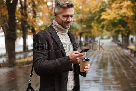 Derűs férfi kabát elvesz fotó természet Stock fotó © deandrobot