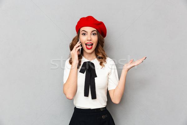 портрет возбужденный школьница равномерный говорить мобильного телефона Сток-фото © deandrobot