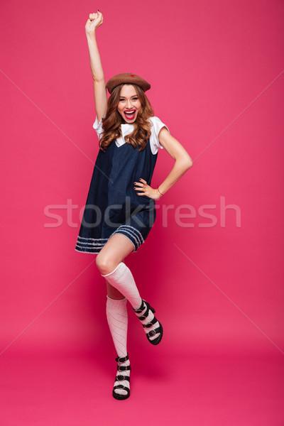 Giovani signora sorridere vincitore gesto Foto d'archivio © deandrobot