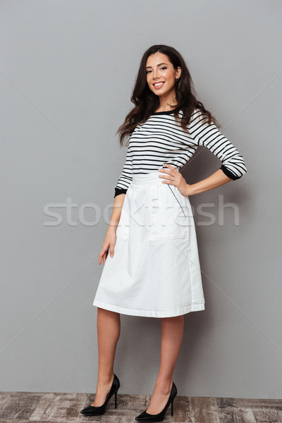 Full length portrait of a woman dressed in a skirt Stock photo © deandrobot