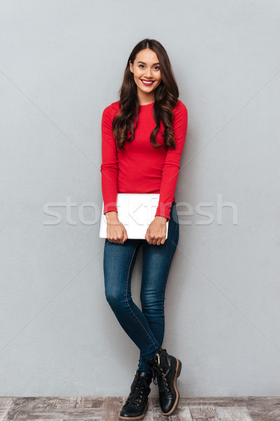 Full length portrait of young beautiful woman in casual wear hol Stock photo © deandrobot