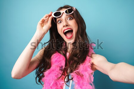 Shocked woman wearing in dress and hat take off sunglasses Stock photo © deandrobot