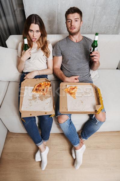 Unhappy couple eating pizza Stock photo © deandrobot