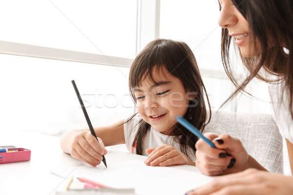Portrait closeup of girl 8y and her mother 20s spending time tog Stock photo © deandrobot