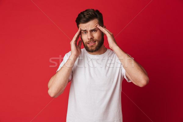 Triste moço dor de cabeça em pé isolado imagem Foto stock © deandrobot