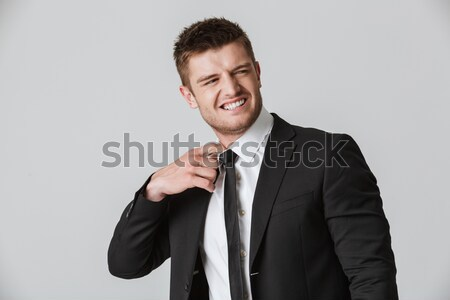 Portrait of an annoyed young businessman in suit Stock photo © deandrobot