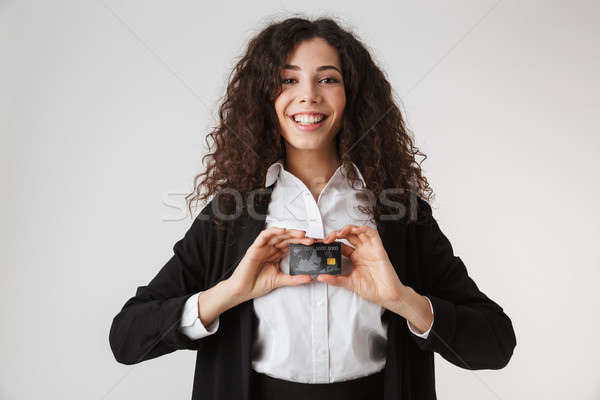 Excited happy young business woman with credit card Stock photo © deandrobot