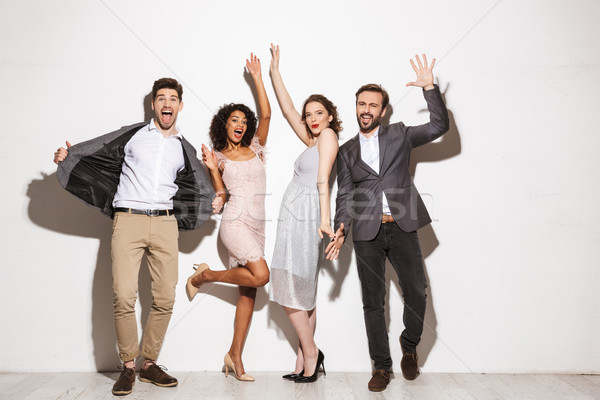 Group of cheerful well dressed multiracial people Stock photo © deandrobot