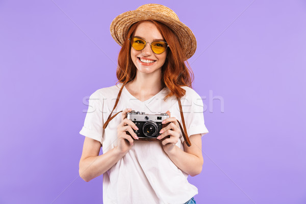 Portrait of a cheerful young girl in straw hat Stock photo © deandrobot