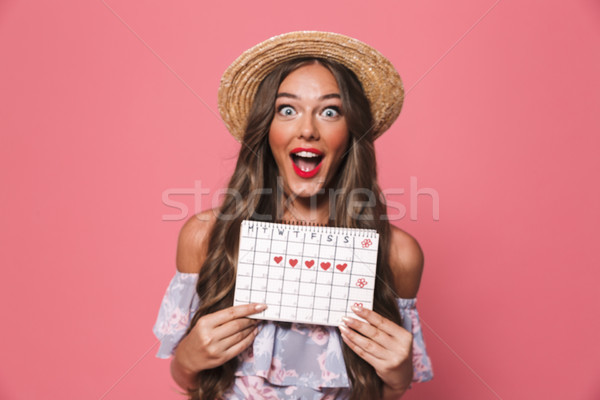 Photo of attractive glamour woman 20s wearing straw hat holding  Stock photo © deandrobot