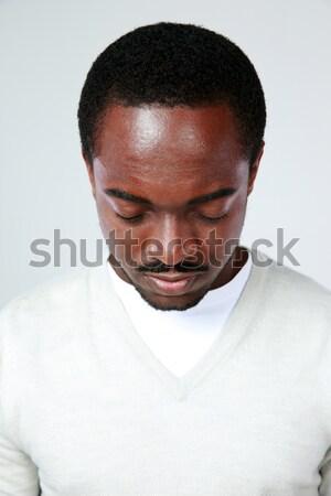 Portret peinzend afrikaanse man grijs zwarte Stockfoto © deandrobot