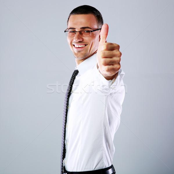 Oldalnézet portré boldog üzletember mutat hüvelykujj Stock fotó © deandrobot