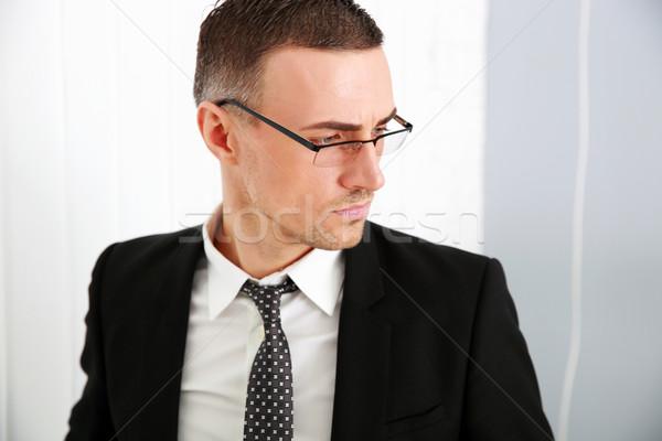 Portre dalgın işadamı gözlük ofis takım elbise Stok fotoğraf © deandrobot