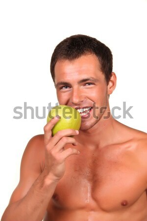 Stock photo: Young sexy man Holding Green Apple
