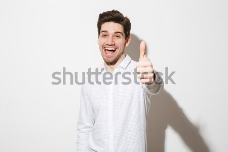 Happy businessman to hang himself with tie Stock photo © deandrobot