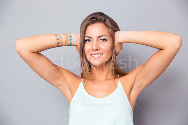 Smiling woman covering her ears Stock photo © deandrobot