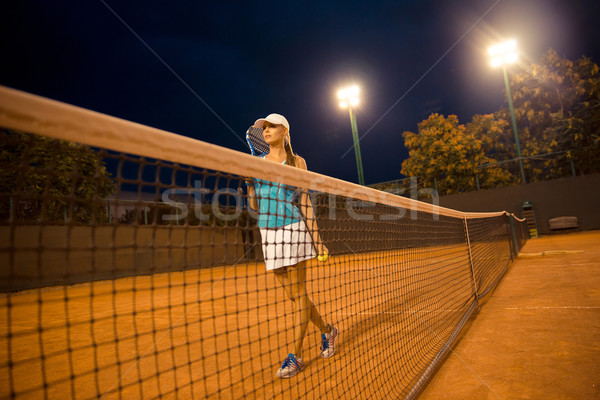 Stock photo: Pretty female tennis player at court