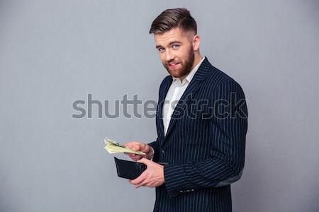 Ritratto ricca imprenditore soldi grigio Foto d'archivio © deandrobot