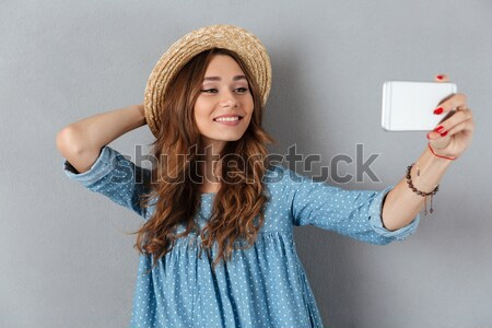 Woman trying to shove tablet computer in her pocket Stock photo © deandrobot
