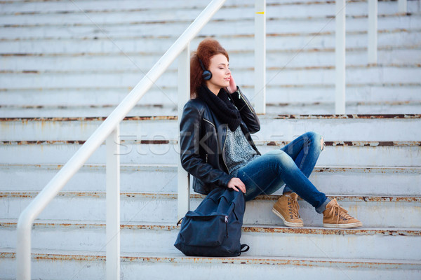 женщину прослушивании музыку лестницы улице портрет Сток-фото © deandrobot