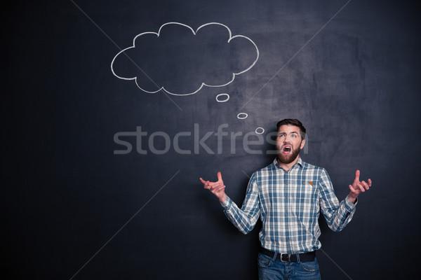 Mérges férfi kiált áll iskolatábla zavart Stock fotó © deandrobot