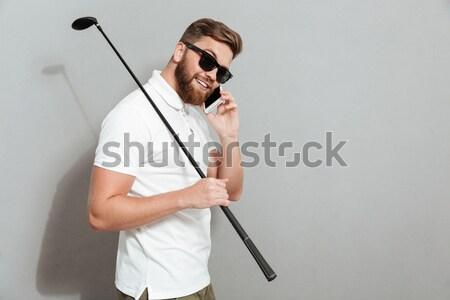 серьезный привлекательный бородатый человека Постоянный рук Сток-фото © deandrobot