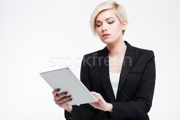 Charming businesswoman using tablet computer Stock photo © deandrobot