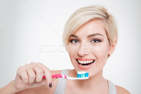 Happy beautiful woman brushing teeth Stock photo © deandrobot