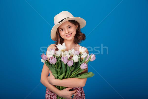 Aranyos boldog kislány virágcsokor virágok portré Stock fotó © deandrobot