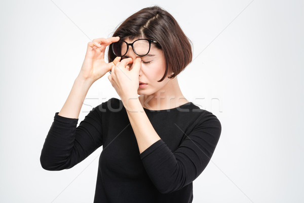 Young woman rubbing her eyes Stock photo © deandrobot