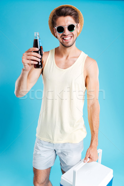 Sorridere giovane raffreddamento bag bottiglia Foto d'archivio © deandrobot