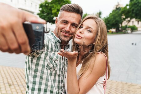 Happy young married couple making selfie at the beach Stock photo © deandrobot