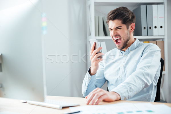 Stock photo: Close-up portrait of businessman in stress talking on phone